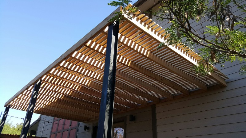 black metal posts on a modern pergola