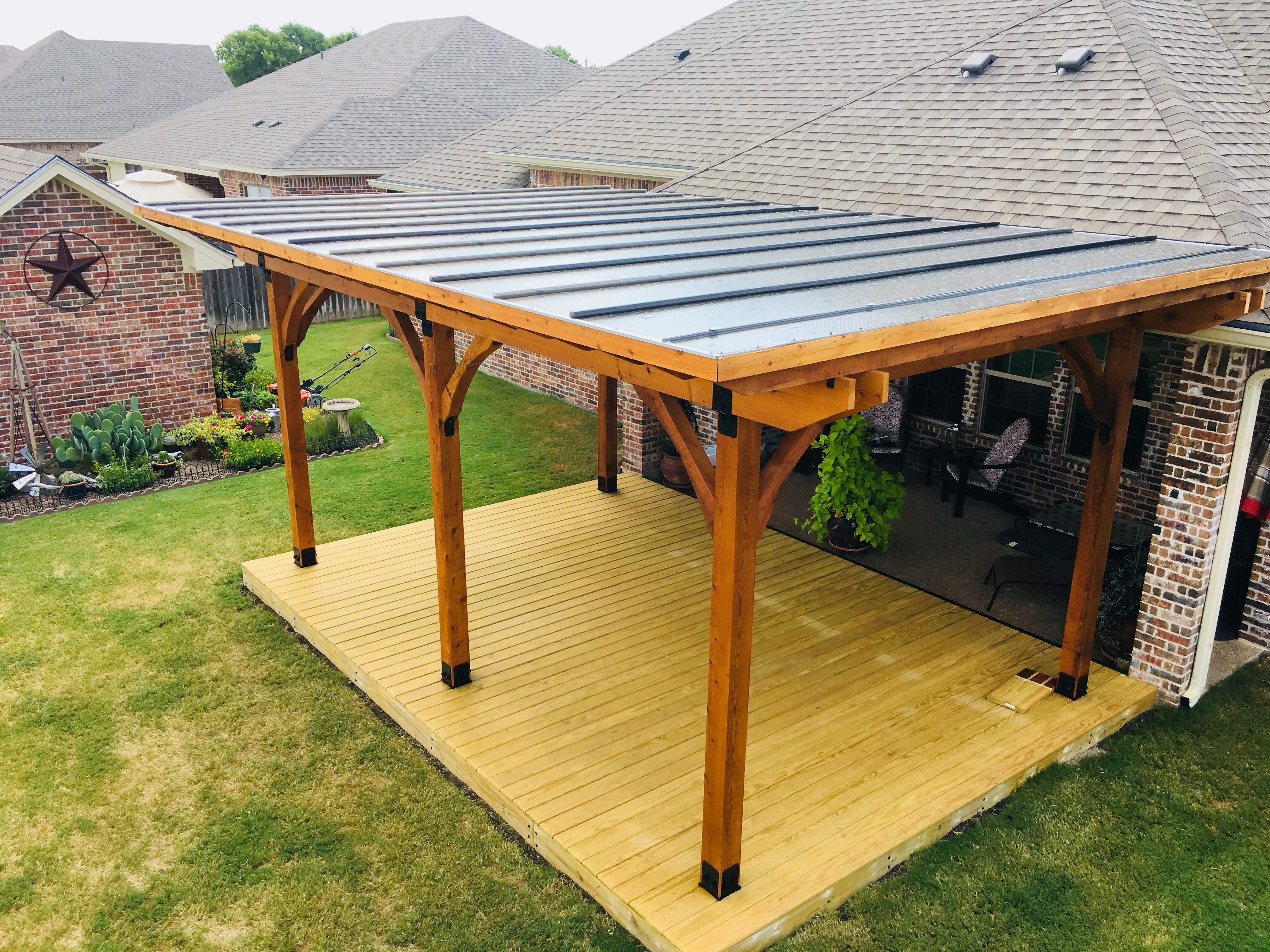 cusom pergola with metal roof and deck